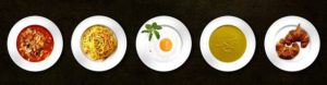 Five small plates of food