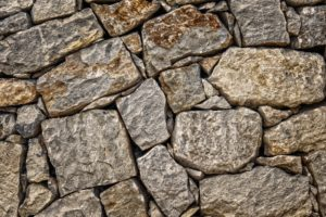 A wall of smooth square stones