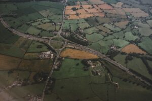 Aerial view of fields and a highway